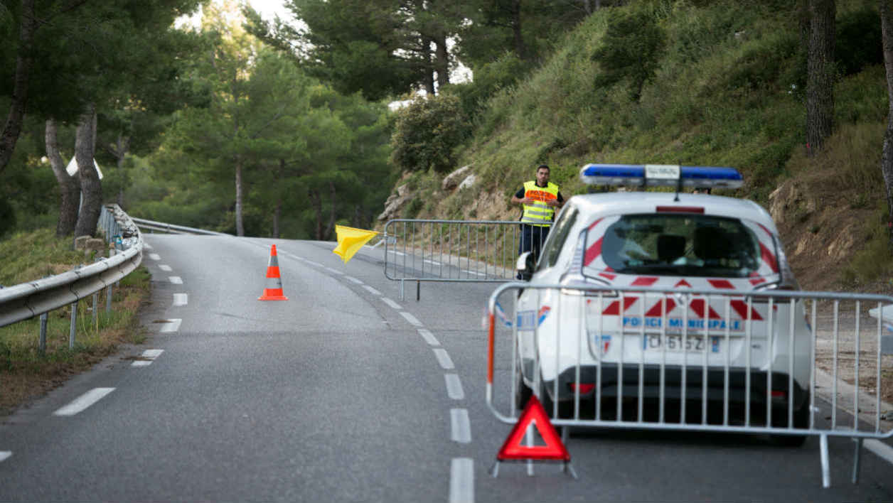 A picture taken on May 14, 2016 in Miramas, southern France, shows a police barrier on a road, where a man died and his son was injured while attending a car race. A spectator was killed on Saturday during tests for the Istres car race, according to French media reports.  BERTRAND LANGLOIS / AFP