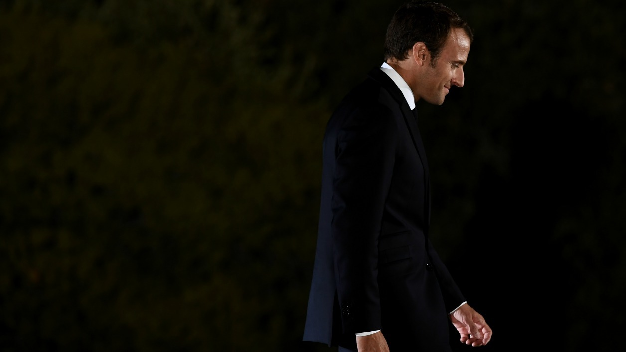 French president Emmanuel Macron leaves the stage after he delivered a speech on Pnyx hill in Athens on September 7, 2017, as part of his two-day official visit to Greece. Macron was holding talks on September 7 with Greek Prime Minister Alexis Tsipras and President Prokopis Pavlopoulos. ARIS MESSINIS / AFP