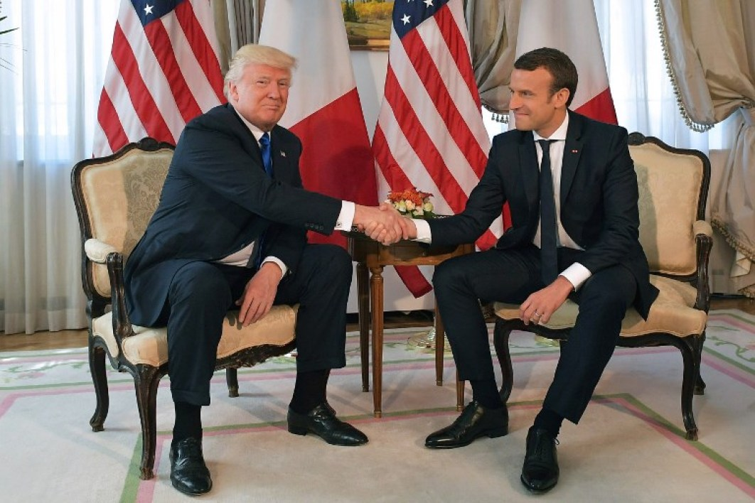 US President Donald Trump (L) and French President Emmanuel Macron (R) speak ahead of a working lunch, at the US ambassador's residence, on the sidelines of the NATO (North Atlantic Treaty Organization) summit, in Brussels, on May 25, 2017.  Mandel NGAN / AFP