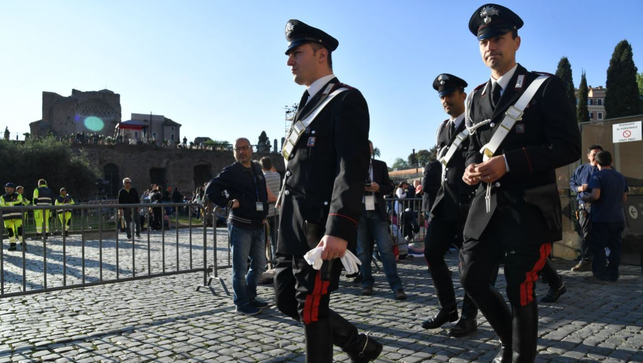 Carabinieri patrol before the arrival of Pope Francis for the Via Crucis (Way of the Cross) torchlight procession at the Colosseum on Good Friday, on April 14, 2017 in Rome.