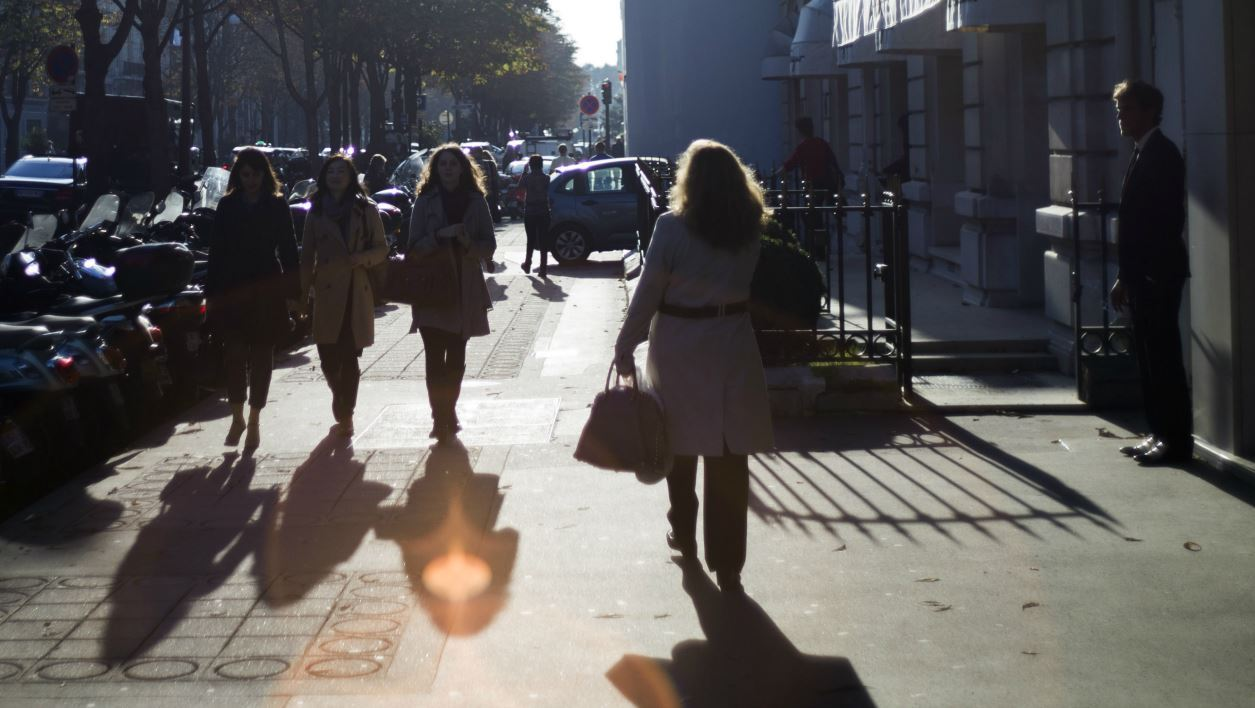 People walk on the George V avenue, a famous shopping street of Paris, on October 23, 2012. AFP PHOTO / FRED DUFOUR FRED DUFOUR / AFP