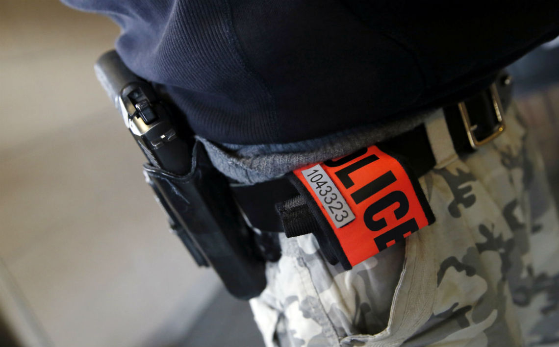 This picture taken on January 13, 2014 shows an officer's identification number on his armband, during a patrol in a Zone de Securite Prioritaire (ZSP, Priority Security Zone) in Sarcelles, a Parisian suburb. Members of the French law enforcement have identification numbers, displayed on their uniforms, since January 1, 2014.