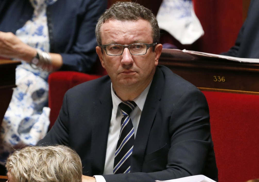 FRANCE, Paris : Left wing deputy Christian Paul listens to a speech prior to a parliamentary confidence vote, on September 16, 2014 at the French national assembly in Paris. Prime Minister Manuel Valls will outline the government's work programme and submit it to a vote, just weeks after former economy minister Arnaud Montebourg stepped out of line and publicly criticised the direction his country was taking, sparking an emergency cabinet reshuffle. AFP PHOTO / PATRICK KOVARIK