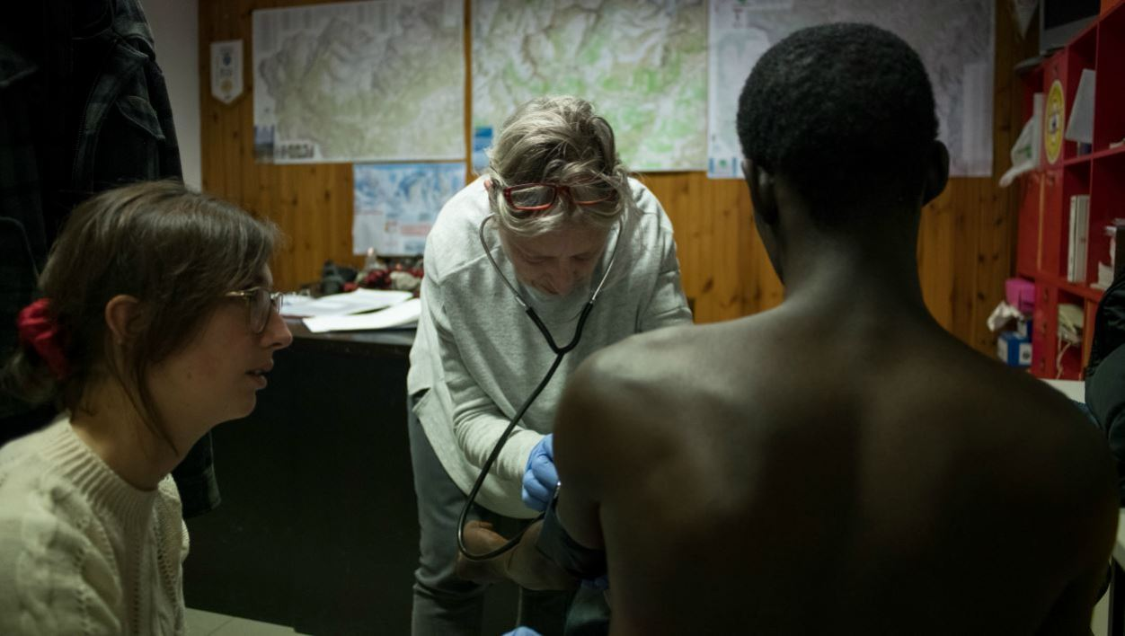 (FILES) In this file photo taken on January 12, 2018 a young migrant from Guinea is treated for suspected tuberculosis by two doctors of NGO 'Rainbow for Africa' as he arrives in Bardonecchia.