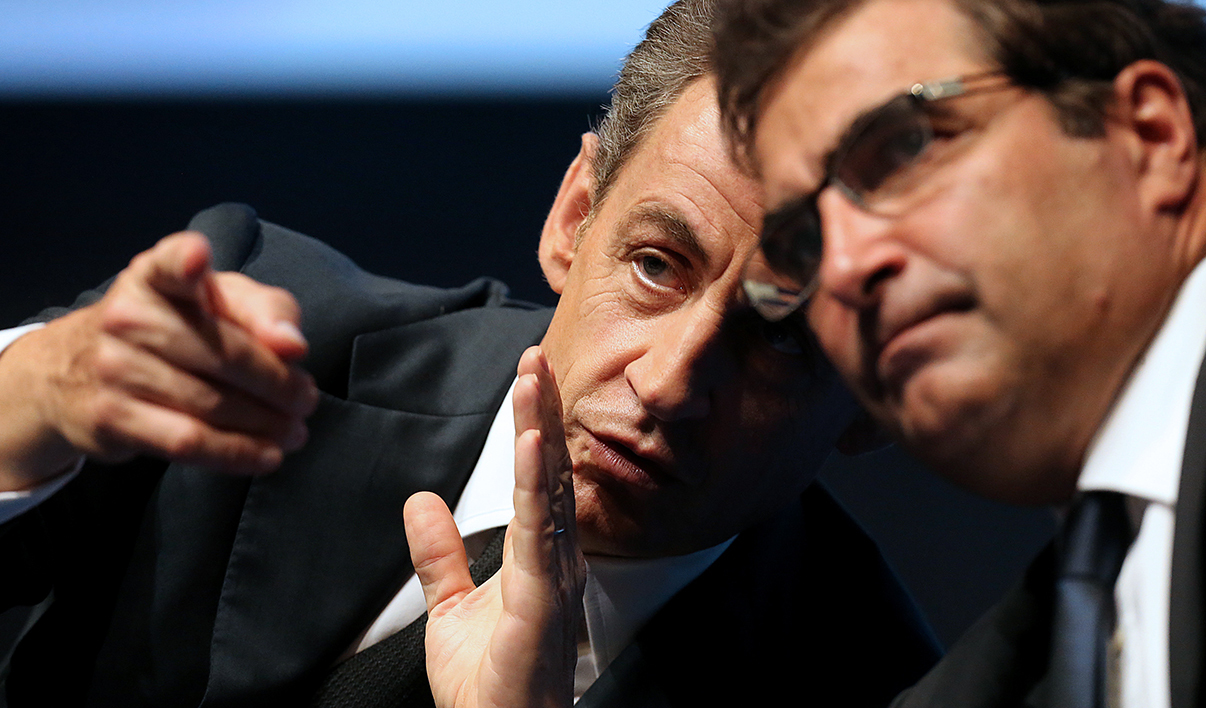 "Head of French right-wing party Les Republicains Nicolas Sarkozy (L) speaks with member of parliament Christian Jacob on the second day of the party's ""Parliamentary days"" on September 24, 2015 in Reims."