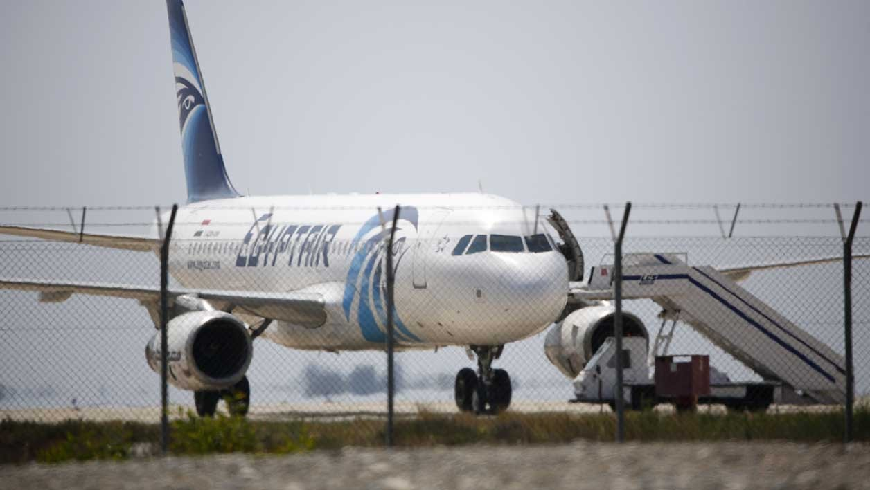 An EgyptAir Airbus A-320 sits on the tarmac of Larnaca airport after it was hijacked and diverted to Cyprus on March 29, 2016. A hijacker seized an Egyptian airliner and forced it to land in Cyprus, but nearly all of the passengers were quickly released and officials said the incident was not linked to terrorism. BEHROUZ MEHRI / AFP