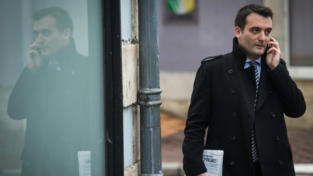 Florian Philippot, top French far-right Front National (FN) party candidate for the French regional elections in the Alsace-Champagne-Ardenne-Lorraine region, makes a phone call as he walks in a street in Delle, eastern France, on December 1, 2015. French regional elections will take place on December 6 and 13, 2015. SEBASTIEN BOZON / AFP
