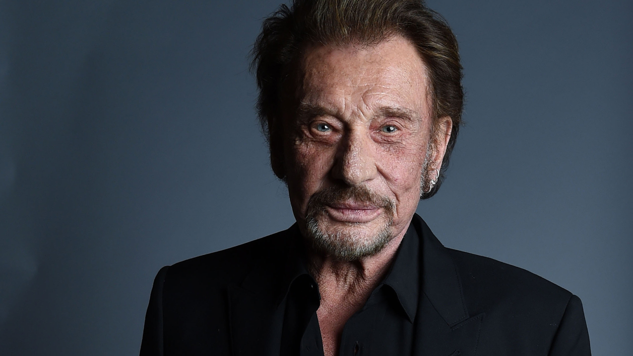 FILES) This file photo taken on April 19, 2016 shows Singer Johnny Hallyday attending the 20th annual COLCOA French Film Festival Opening Night at the Directors Guild of America in West Hollywood, California. France's best-known rock star Johnny Hallyday has died aged 74 after a battle with lung cancer, his wife Laeticia told AFP on December 6, 2017. VALERIE MACON / AFP