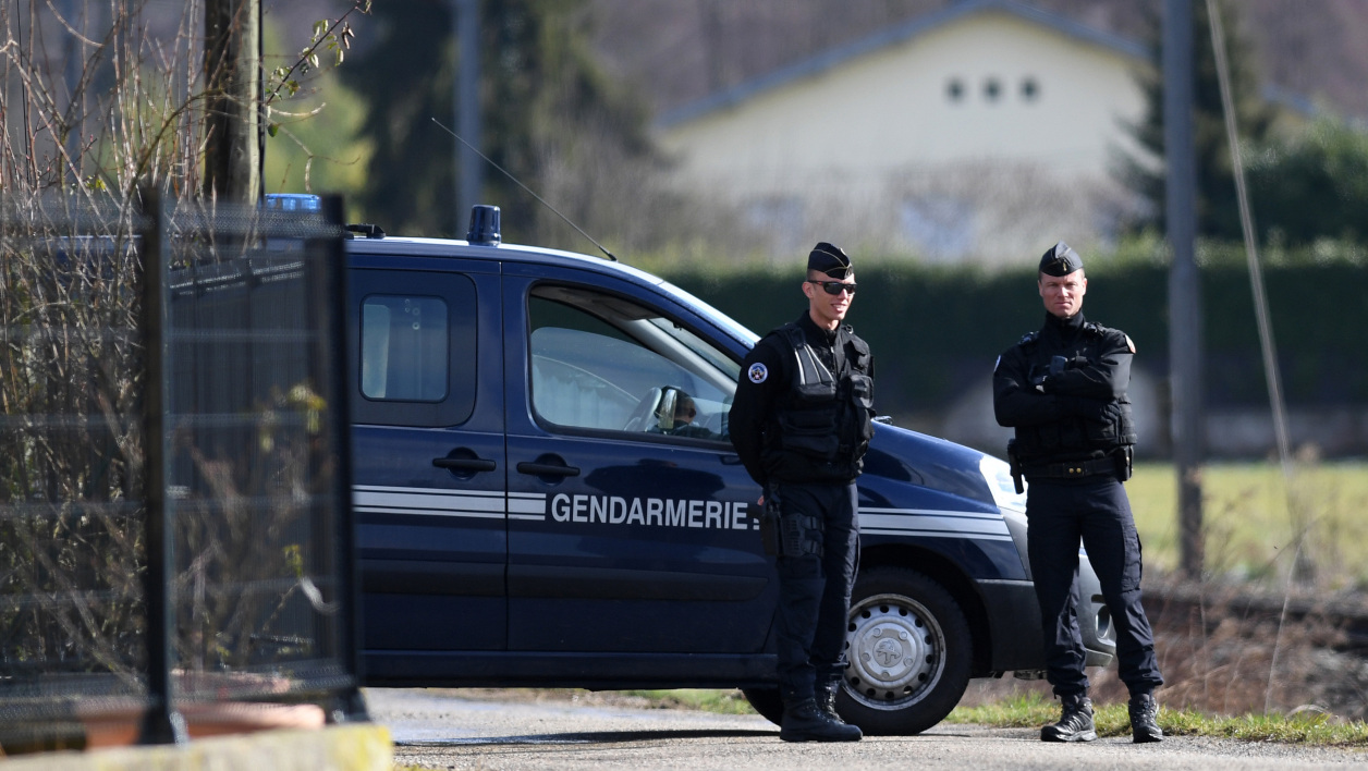 French Gendarmes stand by a vehicle along a road near Domessin in the Eastern French region of Savoie on February 14, 2018 during the transport of suspected killer Nordahl Lelandais.