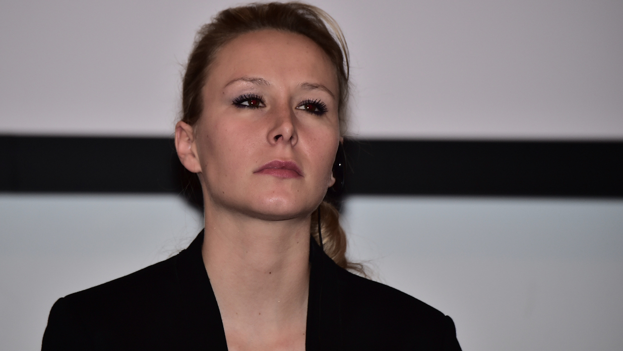 French far-right National Front (Front National - FN) party member of parliament Marion Marechal-Le Pen attends a political meeting in Milan on March 16, 2016.  GIUSEPPE CACACE / AFP