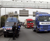 Trucks drive under the Rungis highway bridge with radars set up to collect the environmental tax