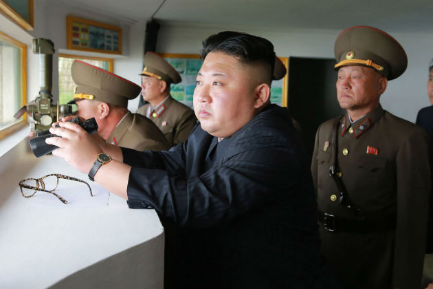 This undated picture released from North Korea's official Korean Central News Agency (KCNA) on May 5, 2017 shows North Korean leader Kim Jong-Un (C) inspecting the defence detachment on Jangjae Islet and the Hero Defence Detachment on Mu Islet located in the southernmost part of the waters off the southwest front.  STR / KCNA VIA KNS / AFP