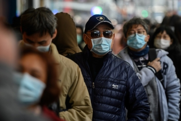 Ressortissants chinois portant des masques - Philip FONG / AFP