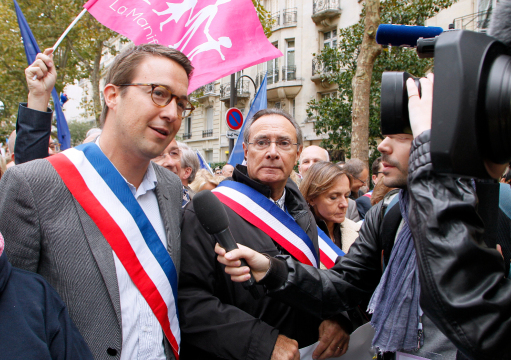 "FRANCE, Paris : French right wing party UMP's former vice president Guillaume Peltier (2ndL) takes part in an anti-gay marriage ""La Manif Pour Tous"" (Protest for Everyone) movement protest against medically assisted procreation and the use of surrogate mothers, on October 5, 2014 in Paris. AFP PHOTO / MATTHIEU ALEXANDRE"
