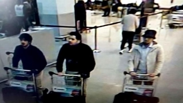 A picture released on March 22, 2016 by the belgian federal police on demand of the Federal prosecutor shows a screengrab of the airport CCTV camera showing suspects of this morning's attacks at Brussels Airport, in Zaventem.  Two explosions in the departure hall of Brussels Airport this morning took the lives of 14 people, 81 got injured. Government sources speak of a terrorist attack. The terrorist threat level has been heightened to four across the country. BELGIAN FEDERAL POLICE / AFP