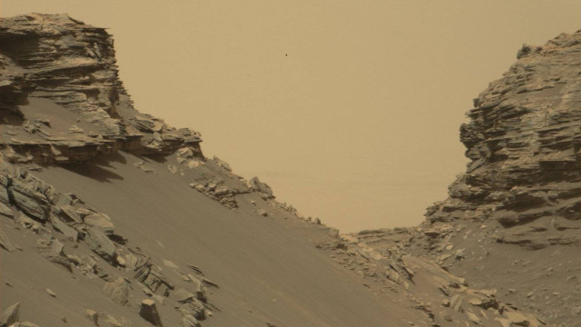 "This photo obtained from NASA shows sloping buttes and layered outcrops within the ""Murray Buttes"" region of Mars on lower Mount Sharp. The image was taken on September 8, 2016, during the 1454th Martian day, or sol, of Curiosity's work on Mars.  HO / NASA/JPL-Caltech/MSSS / AFP"