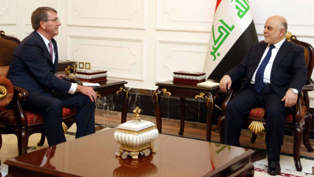 A handout picture released by the Iraq Prime Minister's Press Office shows Iraqi Prime Minister Haidar al-Abadi (R) meeting with US Pentagon chief Ashton Carter in Baghdad