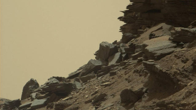 "This photo obtained from NASA shows a hillside outcrop with layered rocks within the ""Murray Buttes"" region of Mars on lower Mount Sharp. The image was taken on September 8, 2016, during the 1454th Martian day, or sol, of Curiosity's work on Mars.  HO / NASA/JPL-Caltech/MSSS / AFP"