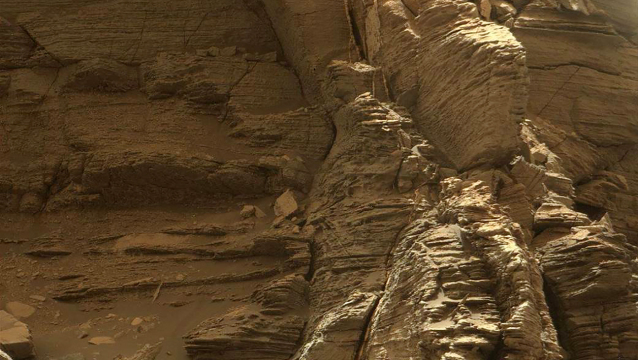 """This handout image obtained from NASA on September 10, 2016 shows a view from the Mast Camera (Mastcam) on NASA's Curiosity Mars rover taken on on September 8, 2016 featuring an outcrop with finely layered rocks inside the """"Murray Buttes"""" region on lower Mount Sharp on Mars.  HO / NASA / AFP"""