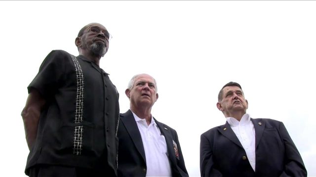 """This still image obtained August 13, 2015 courtesy of US State Department video shows F.W. """"Mike"""" East (L) , Larry C. Morris (C) and Jim Tracy (R) in Washington, DC. The three now retired US Marines who lowered the US flag at the American embassy in Cuba in 1961 will be back in Havana on August 14, 2015 with US Secretary of State John Kerry to raise the Stars and Stripes once again. AFP PHOTO / US STATE DEPARTMENT"""